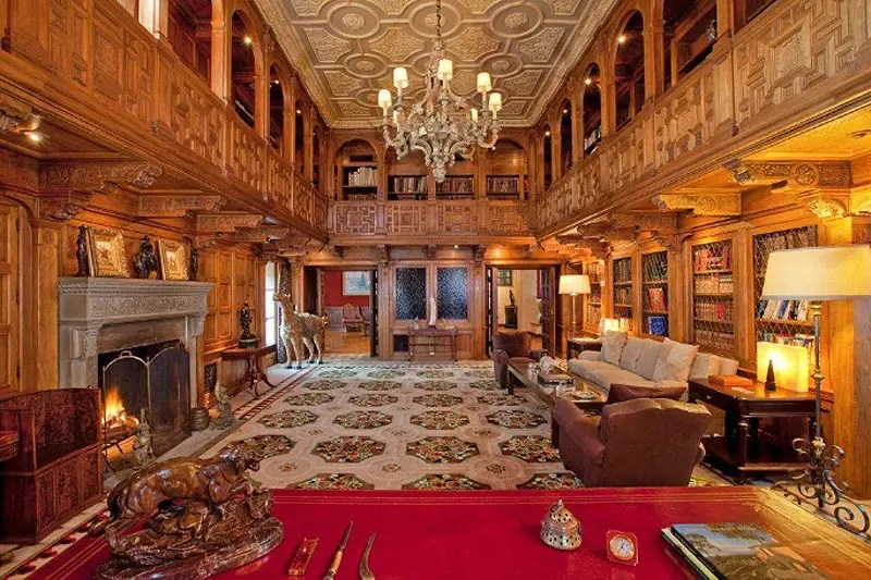 The library has a second-story wrap-around balcony and a huge wood-burning fireplace.