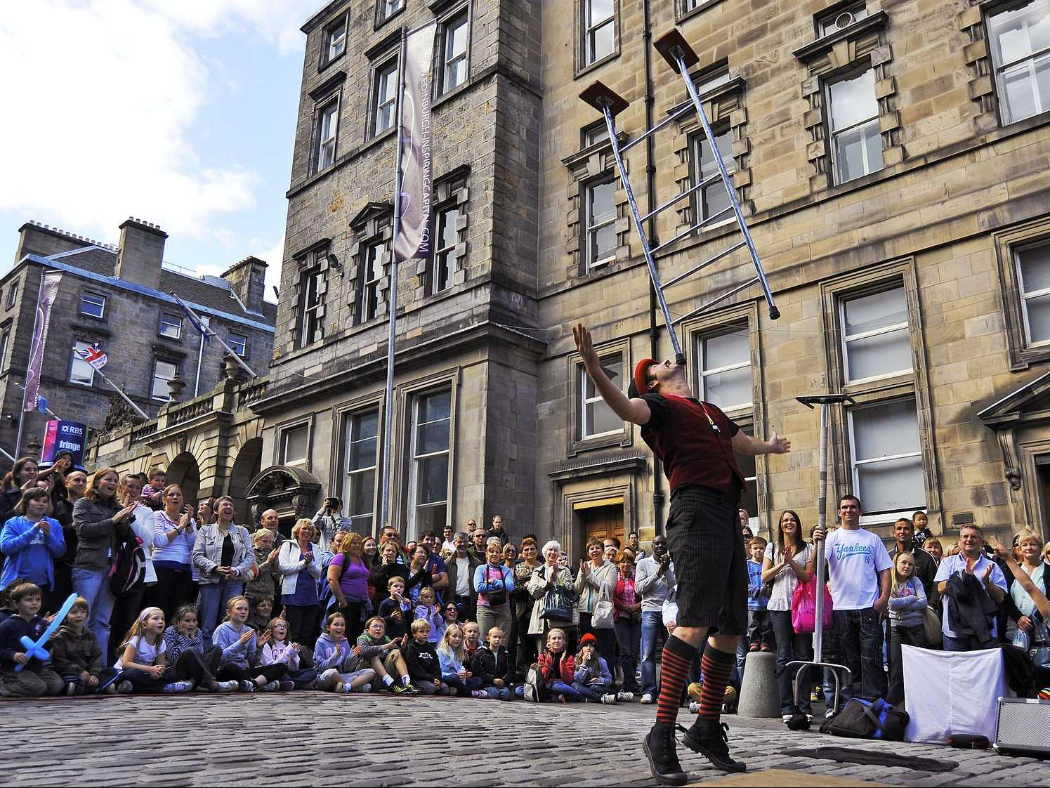 Catch a show at Scotland's Edinburgh Fringe Festival, the world's largest arts festival.