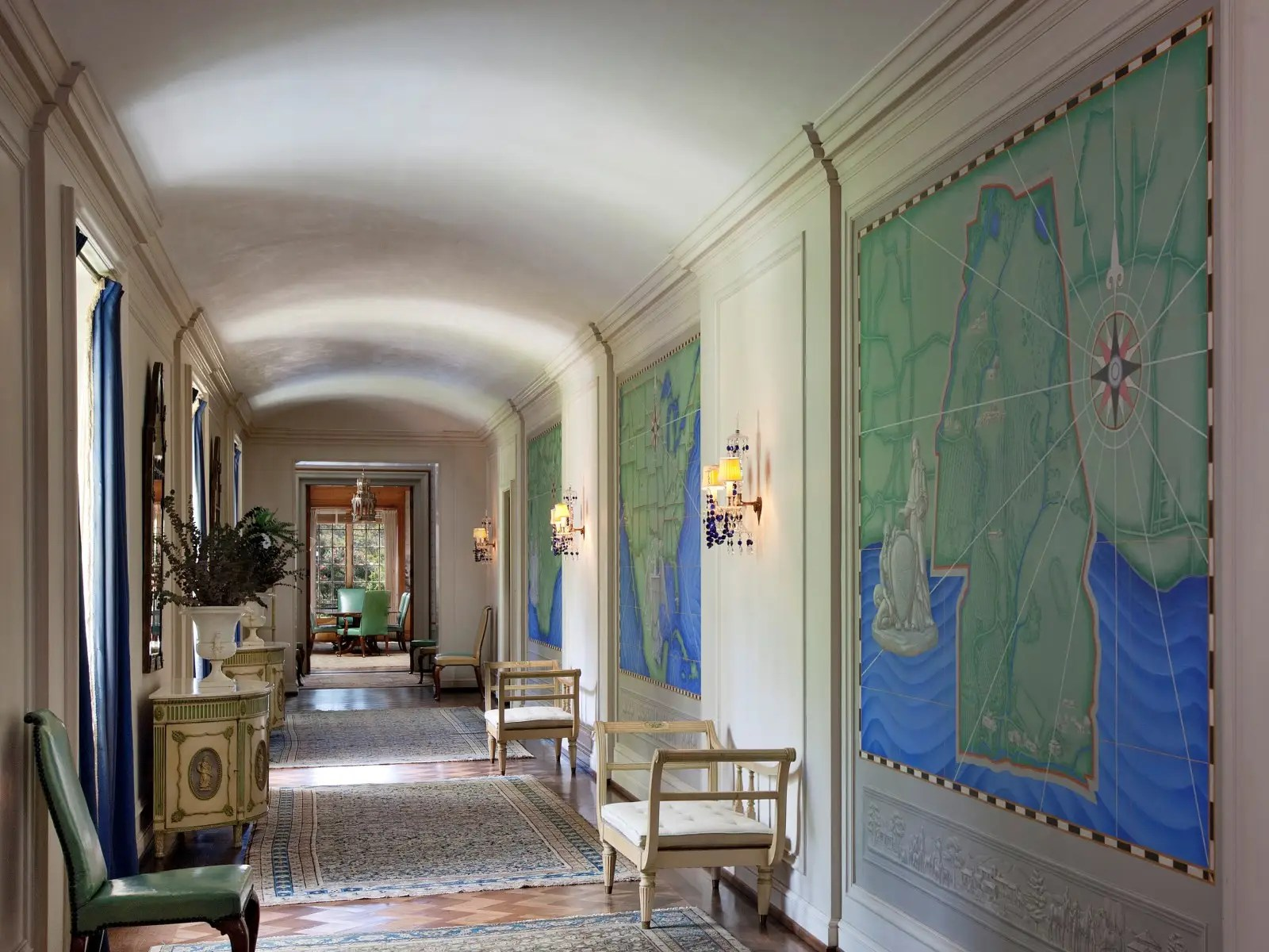 The barrel vaulted central gallery, which connects the lower level to the upper bedroom wings, is lined with hand-painted period murals.