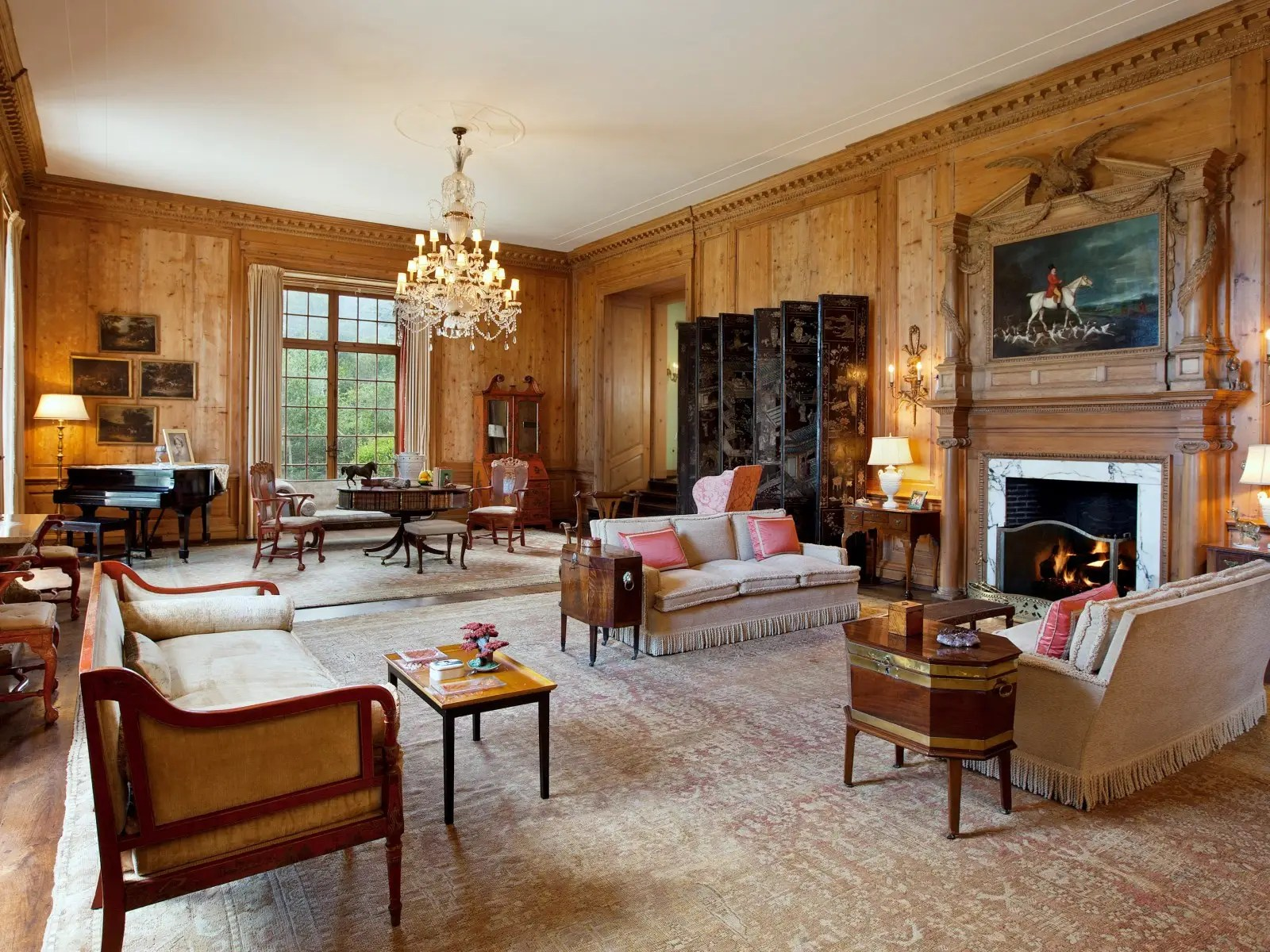 The rooms hearken back to a previous era of grandeur with tall ceilings and paintings.