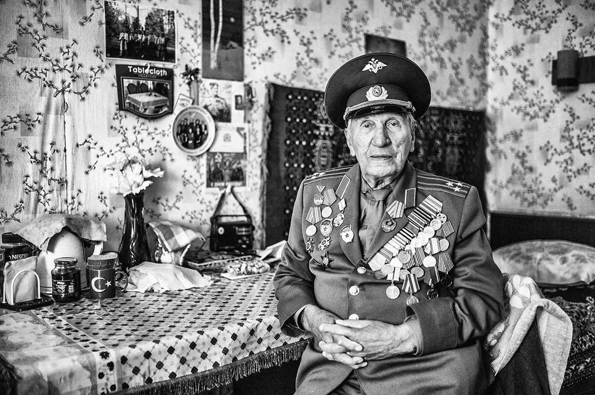 "Petr, age 97. Profession: Electrician, retired colonel. Passion or Dream: ""I dream of living for more than 100 years."""