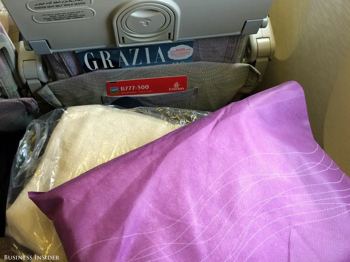 Each seat came with a wrapped blanket and pillow ...