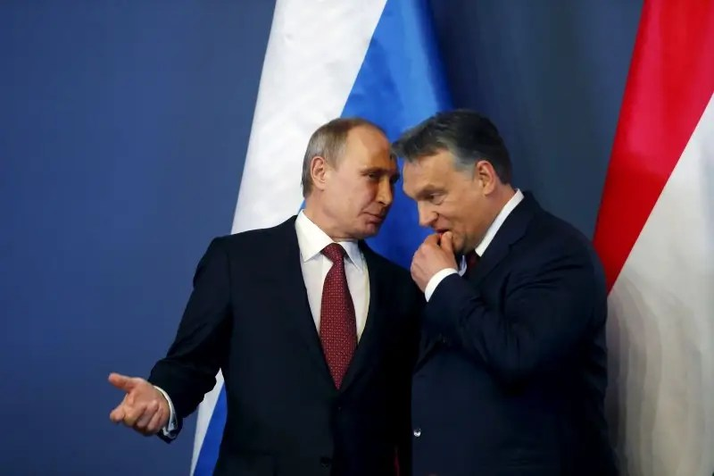 Russian President Vladimir Putin (L) speaks with Hungarian Prime Minister Viktor Orban before a joint news conference in Budapest in this February 17, 2015 file photo. REUTERS/Laszlo Balogh/Files