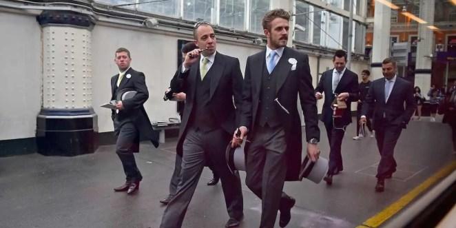 businessmen suits fancy train