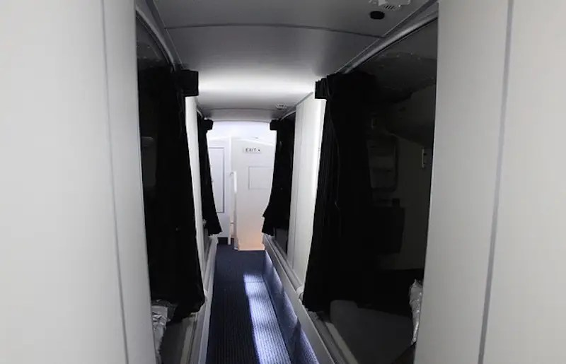 Other planes, like this American Airlines Boeing 773, have partitioned-off beds along an aisle. The aisle is so low that you have to duck to walk through it.