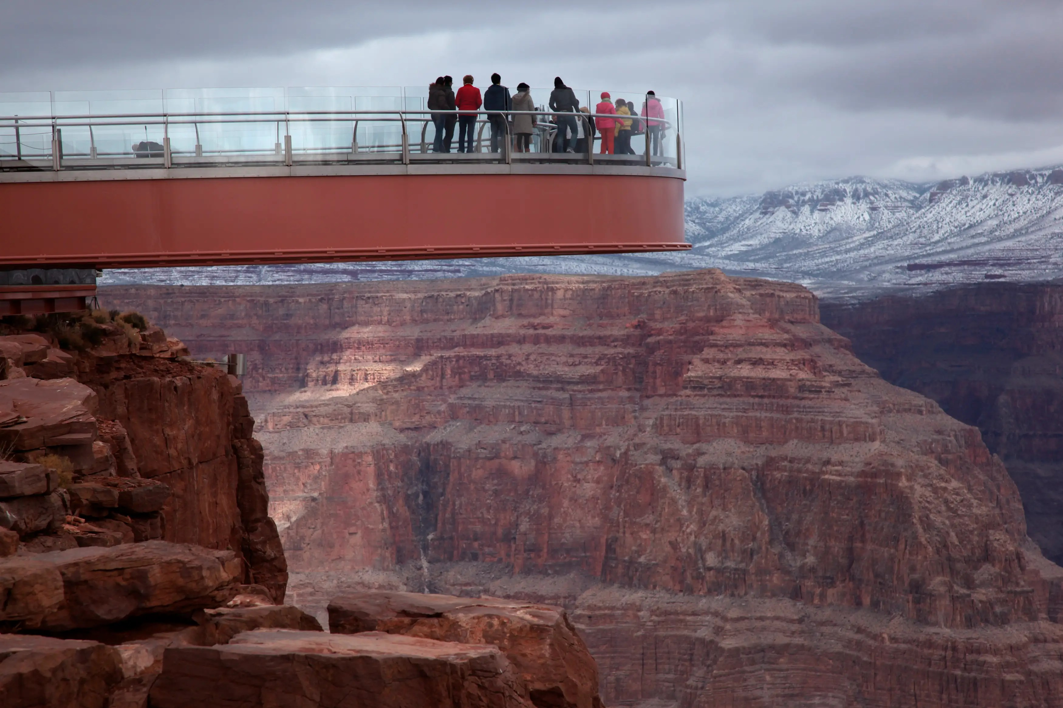 Visitors stand on a skywalk extending out over the Grand Canyon in this view on the Hualapai Indian Reservation, Arizona.