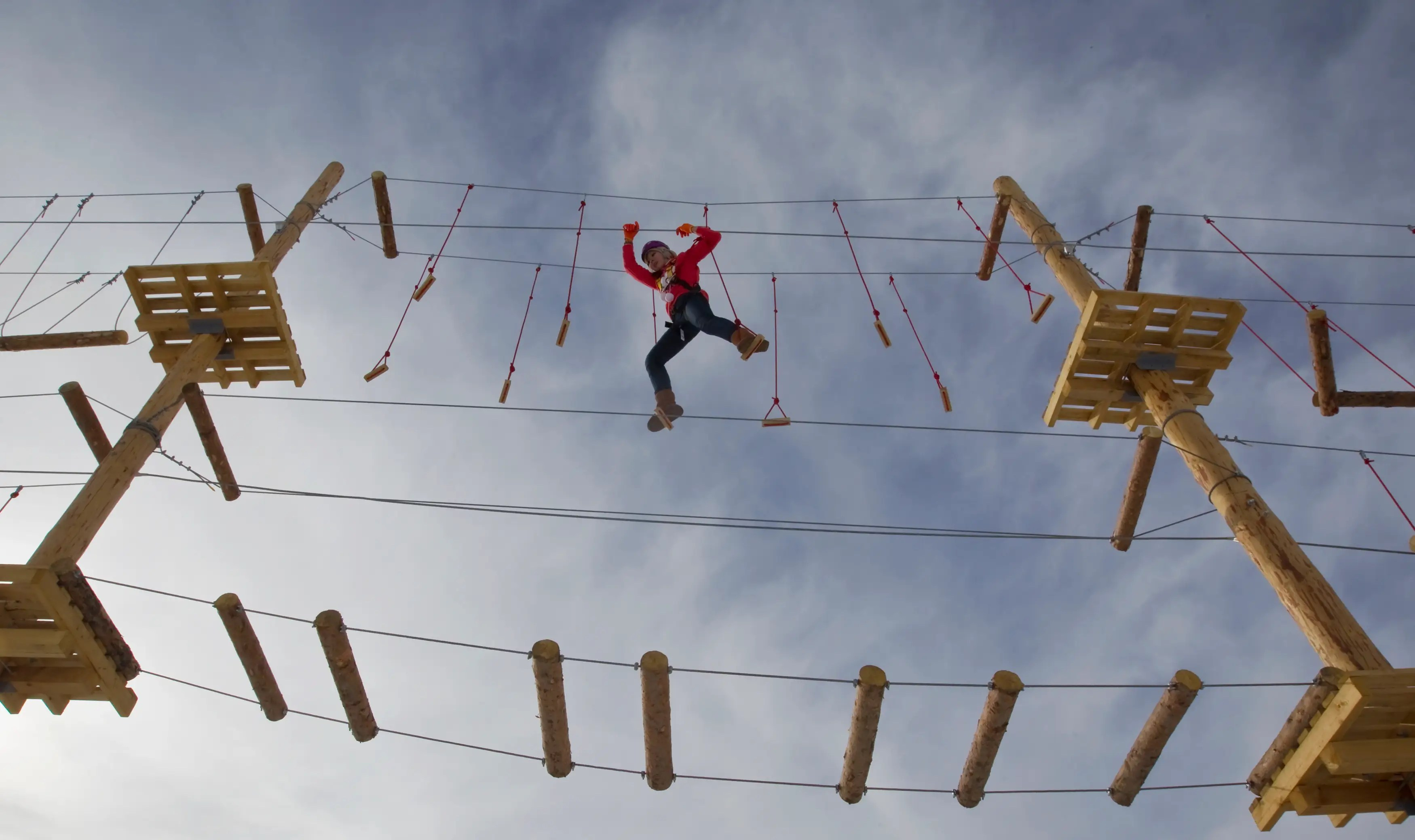 A woman climbs during the opening of the rope park at the Shimbulak Ski Resort in the Tien Shan mountains outside Almaty in Kazakhstan.