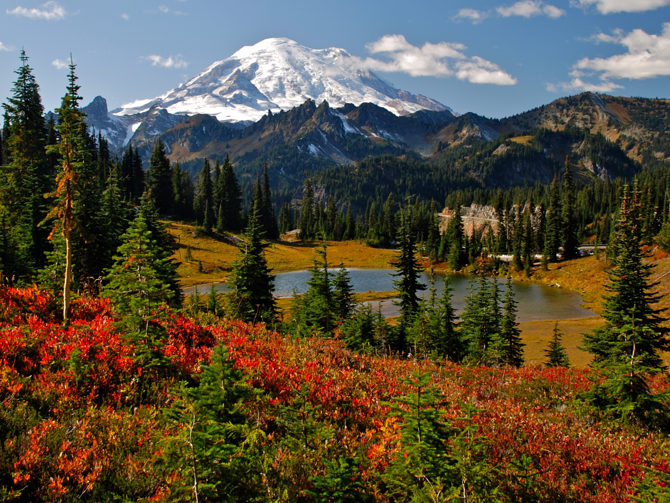 The iconic Mount Rainier — an active volcano and the most glaciated peak in the contiguous US — can be found in Mount Rainier National Park in Washington. Glaciers mantled Mount Rainier for most or all of its 500,000-year lifespan, but they have been continuously retreating due to increasingly warmer summers over the last 30 years.
