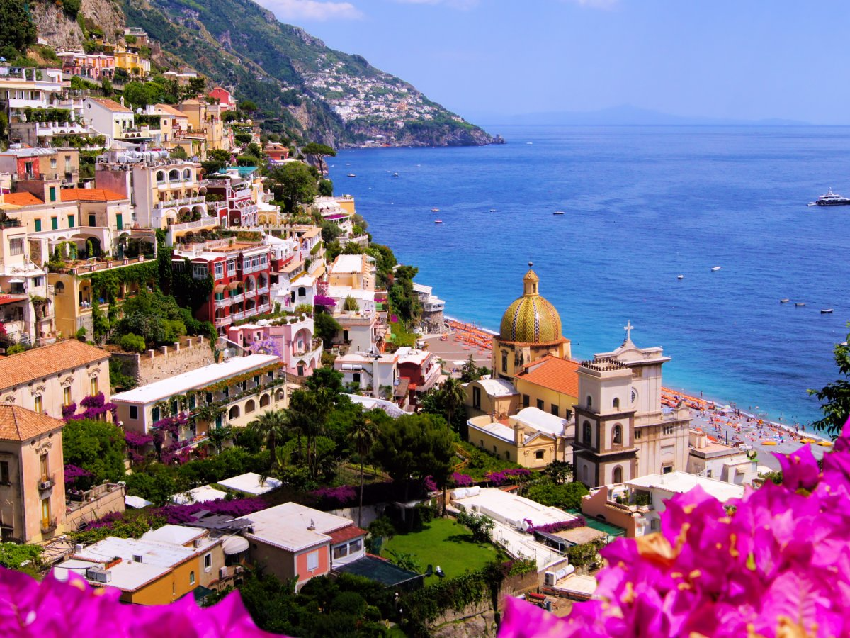 A favorite destination for celebrities, the coastal town of Positano, Italy, stuns travelers with its beautiful mix of colors as white, pink, and yellow homes combine with the blue waters of the Mediterranean below. Walk around and explore its chic boutiques, trendy restaurants, and colorful streets.