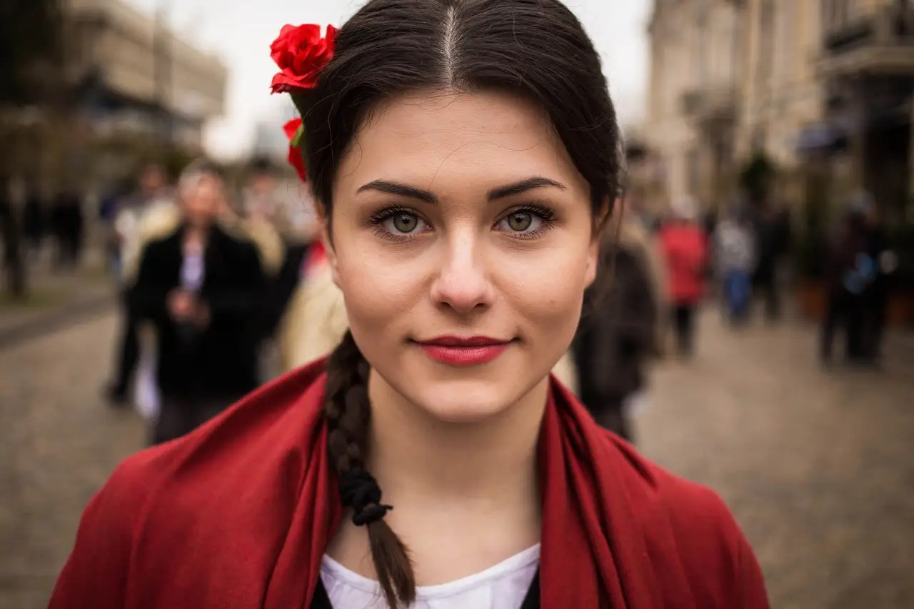 "Noroc has spent three years traveling for her ""Atlas of Beauty"" series. This woman was photographed on the streets of Moldova."