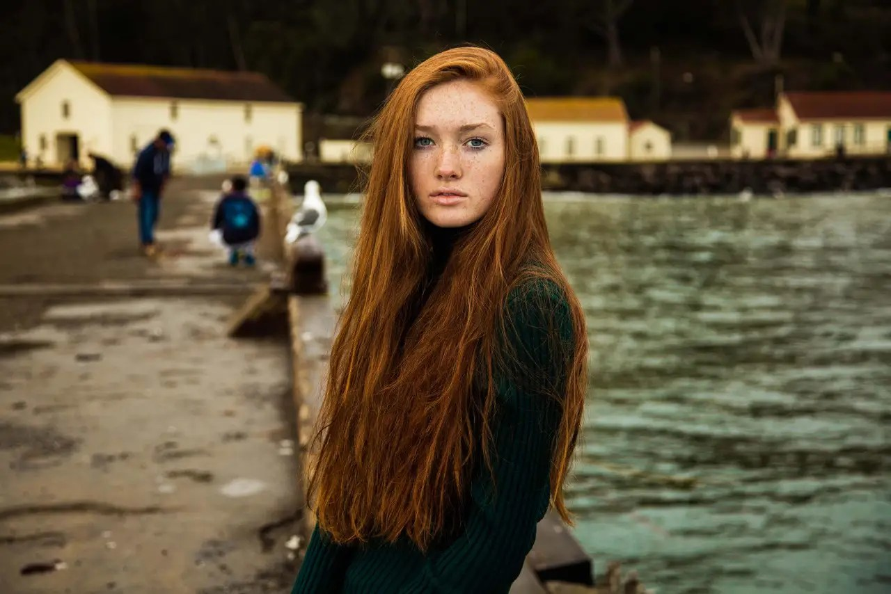 "But her project has received criticism for showing a narrow a definition of beauty. ""There is also negative feedback sometimes, but you have to accept it, even if you find it unfair,"" she says. Below, a redheaded woman posing in San Francisco, USA."