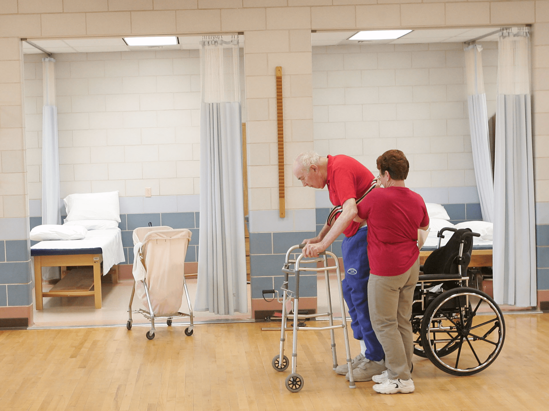 elderly old aging wheelchair cane walking nursing home physical therapy PT