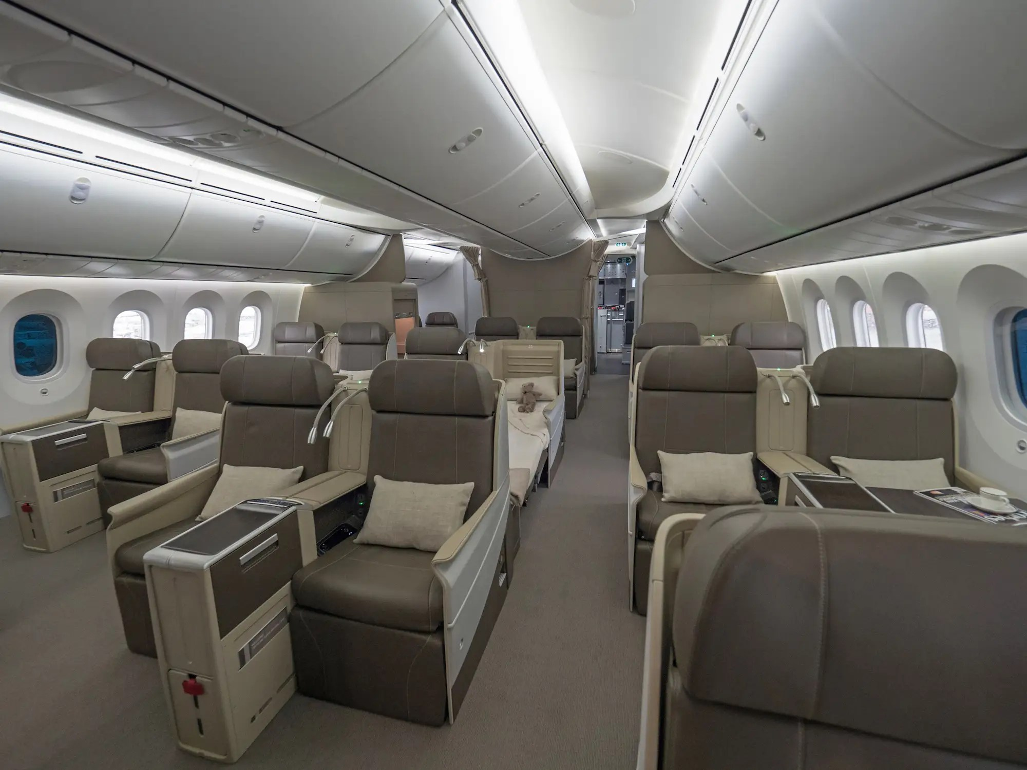 Aft of the round VIP lavatory is the guest cabin. It features 18 full-flat, first-class sleeper seats. Behind the guest cabin is a row of six premium economy seats for the staff.