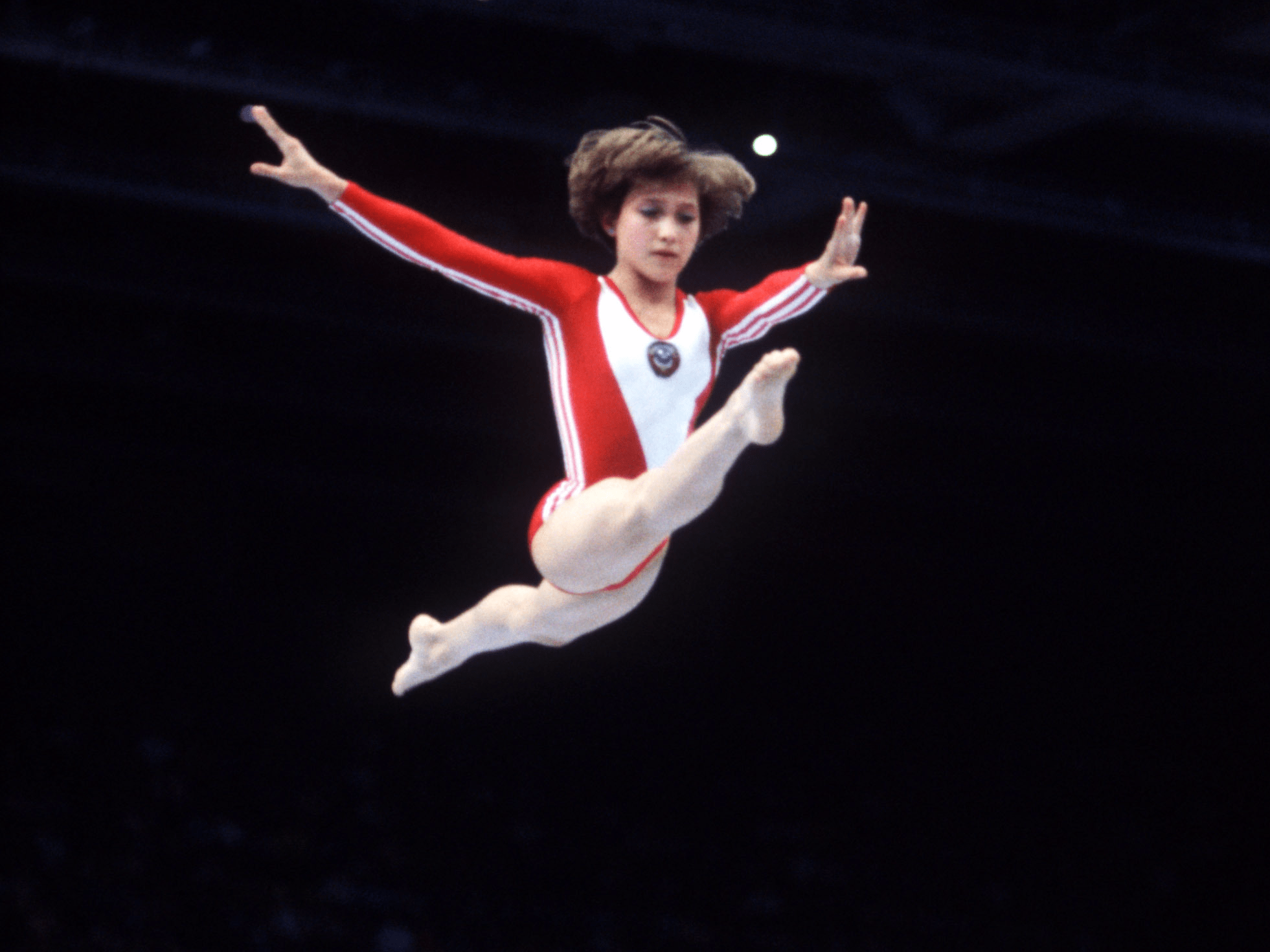 Moscow, 1980: With the Cold War ongoing, the US boycotted the Moscow games and also urged their allies to do the same to protest the Soviet invasion of Afghanistan. This image shows the USSR's Yelena Davydova in action on the beam.