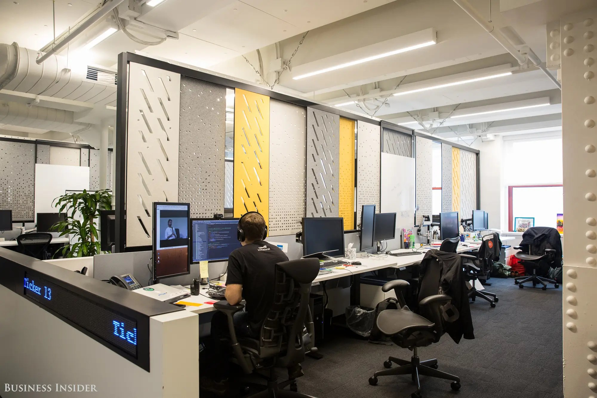 The main office space features an open layout. LinkedIn's workspace is malleable, featuring panels that employees can slide and adjust.