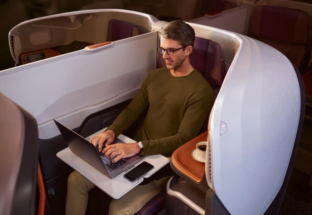Each business class seat is 25-inches wide with 50 inches of pitch and is cocooned inside a carbon composite shell for added privacy. The seats also convert into a 78-inch long bed. Like the suite, the business class seat is also upholstered by Poltrona Frau.