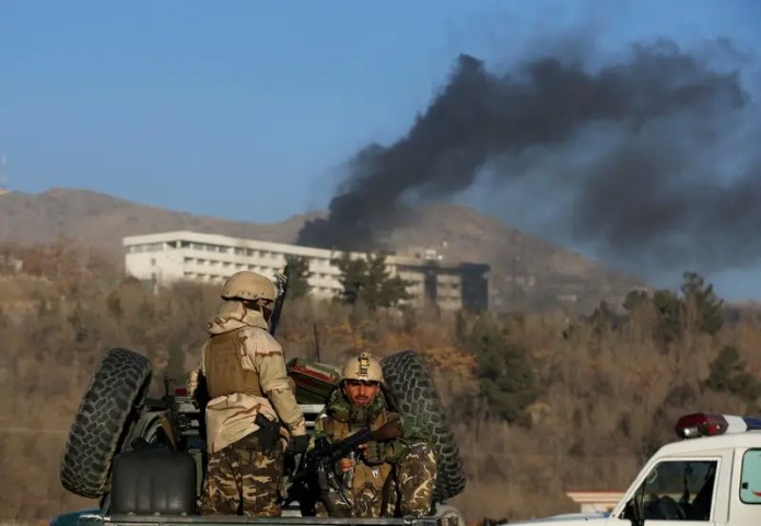 FILE PHOTO - Afghan security forces keep watch as smoke rises from the Intercontinental Hotel in Kabul,Afghanistan, January 21, 2018. REUTERS/Omar Sobhani