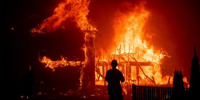 A home burns as the Camp Fire rages through Paradise, California, on Thursday
