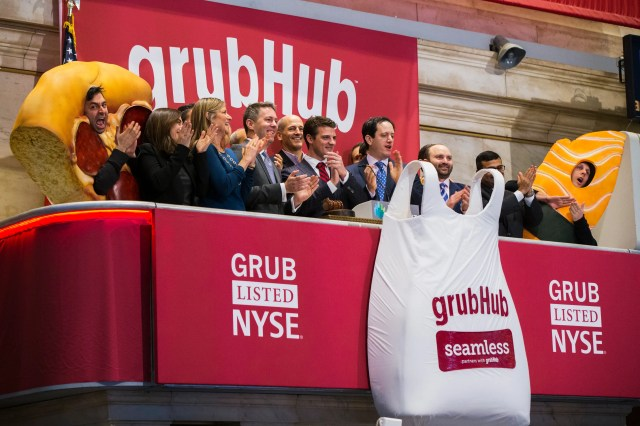 Grubhub CEO Matt Maloney (C) applauds after ringing the opening bell before the company's IPO on the floor of the New York Stock Exchange in New York April 4, 2014. Shares of GrubHub Inc, the biggest U.S. online food-delivery service, rose as much as 57 percent in its market debut as investors scrambled for a piece of the fast-growing consumer internet company. REUTERS/Lucas Jackson