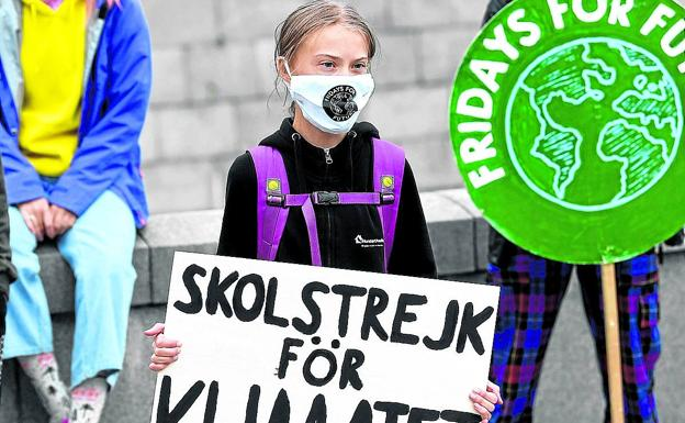 Greta Thunberg at a protest in front of the Swedish Parliament.