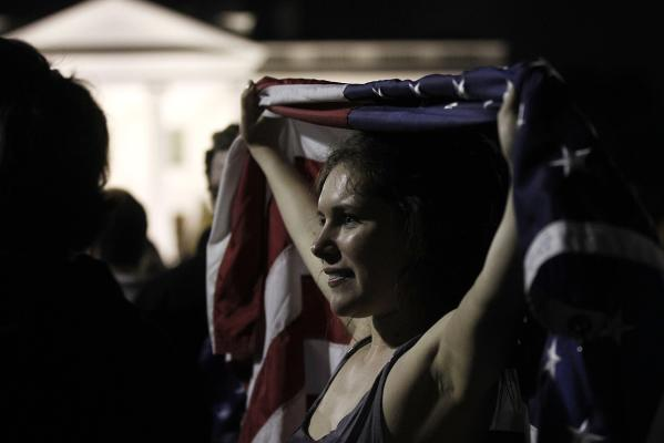 Allyson Childress joins the crowds celebrating on Pennsylvania Avenue in front of the White House.