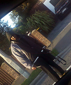 ARMED: A picture of Zakariye Mohammed Hussein taken by a bystander from inside his car mid-rampage.