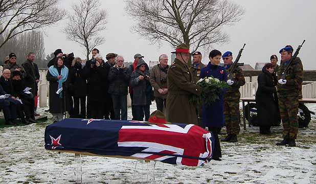 REBURIED UNDER A SILVER FERN: Lt Gen Rhys Jones lays a wreath during the reburial service at Messines Ridge British Cemetery.