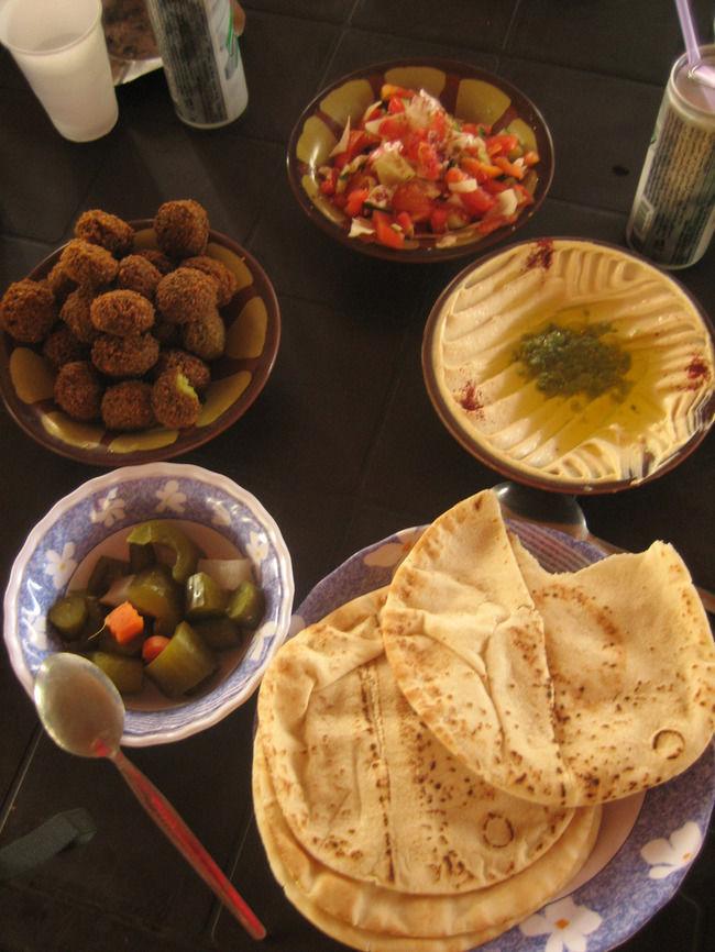 Jordan food -Hummus, falafel, salad, pickles and khubz (pita). A typical Jordanian breakfast.