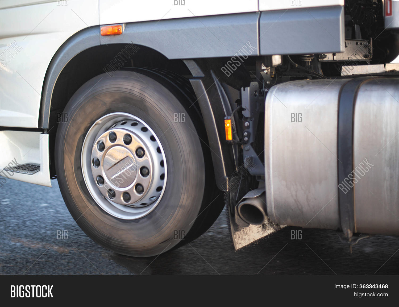 spinning wheel truck image photo
