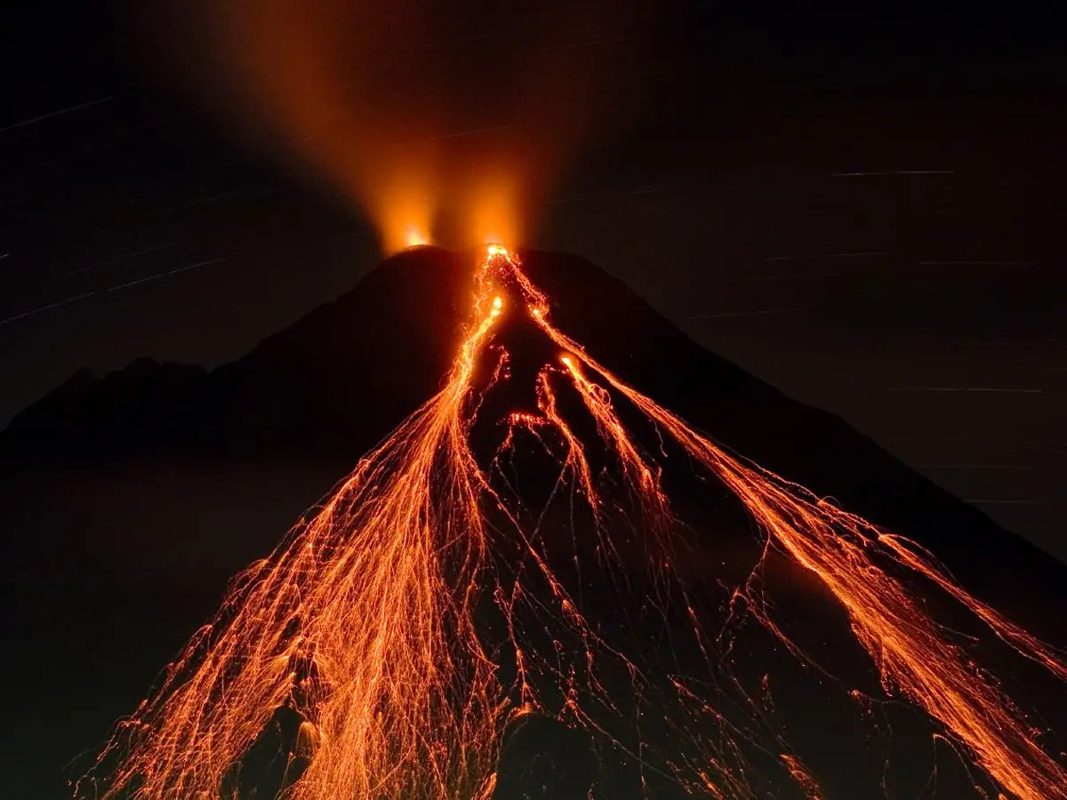 Watch an active volcano erupt in Arenal, Costa Rica.