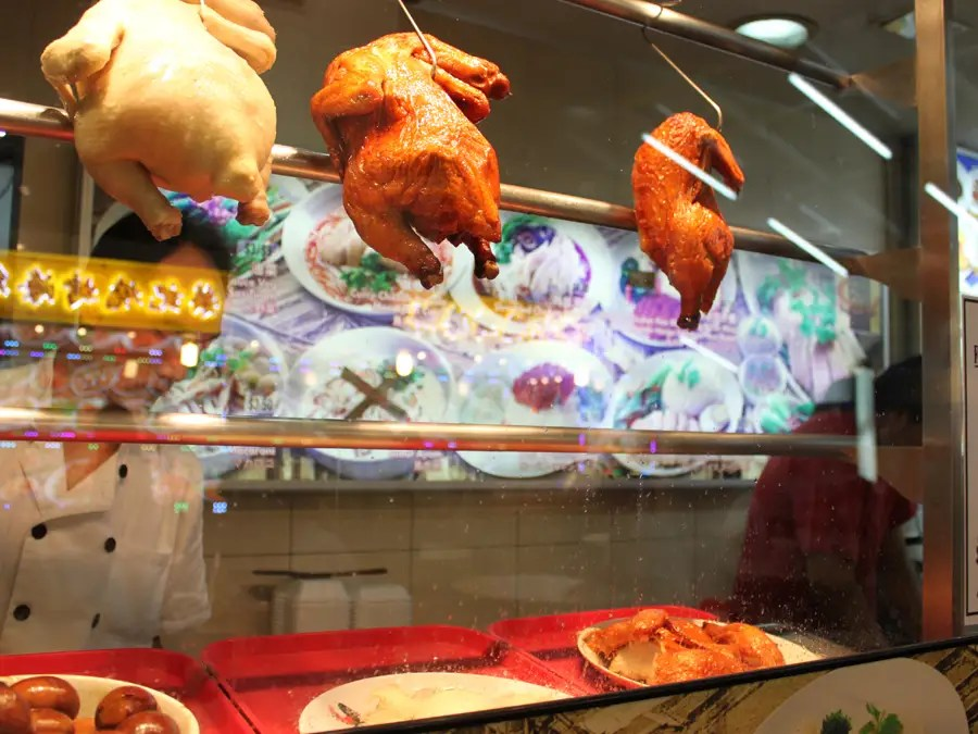 You'll find roast chickens and ducks hanging in restaurant windows and hawker center stalls all around Singapore.