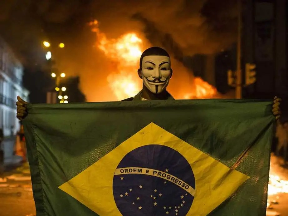 brazil world cup protests masked man fire
