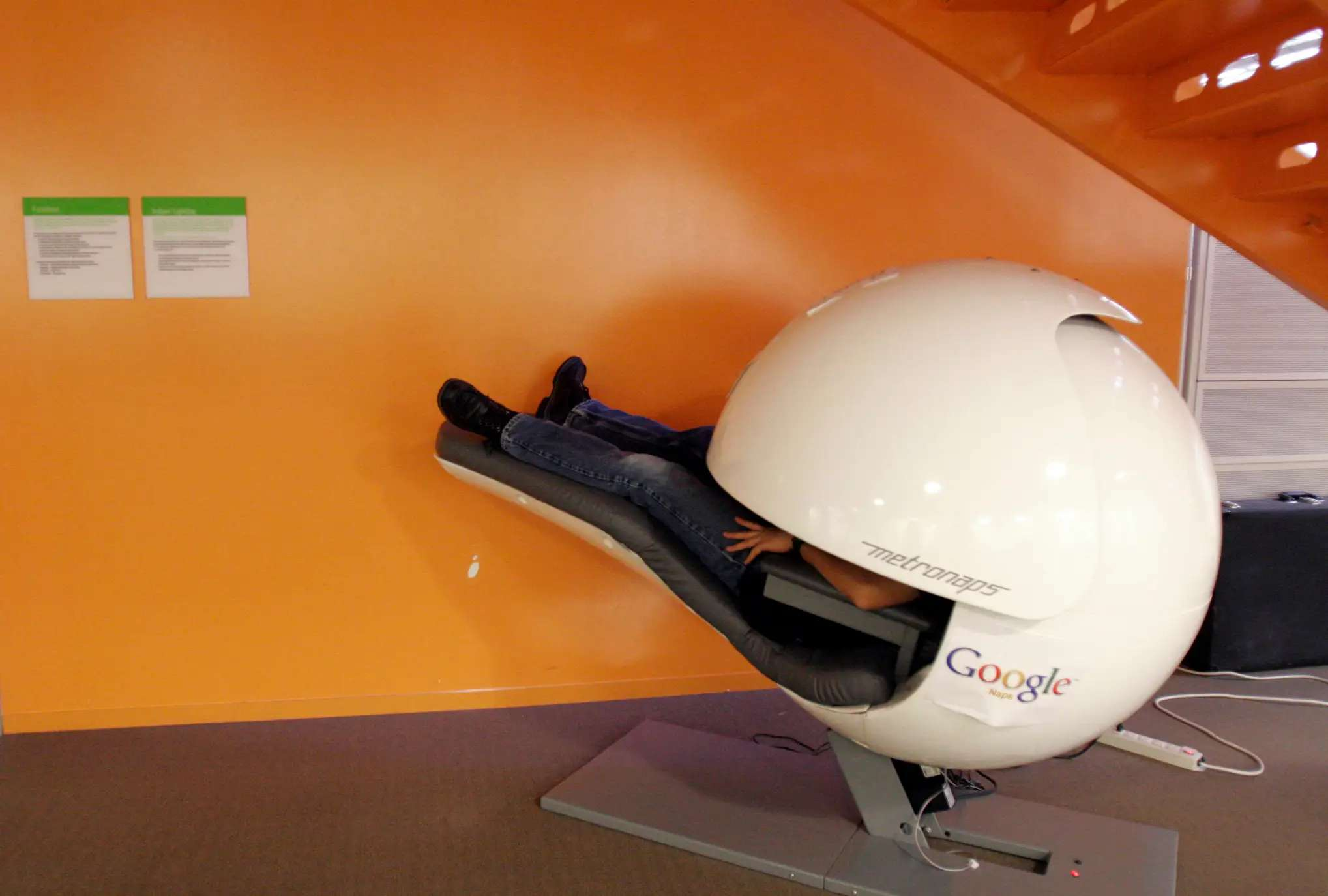 "Note the Google logo on this ""nap pod"" where employees can work or sleep."