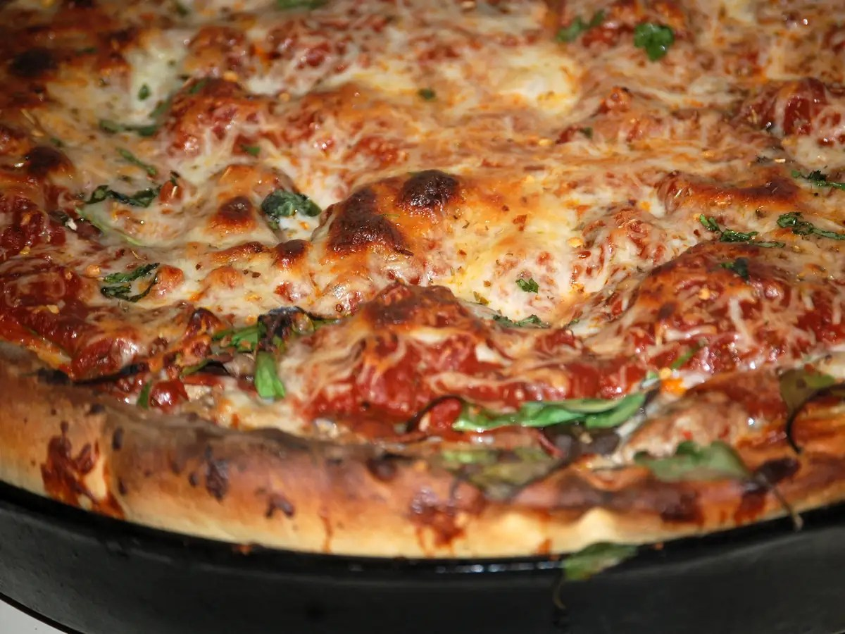 ILLINOIS: Bite into the cheese-oozing sauce and crust of a Chicago-style deep dish pizza.