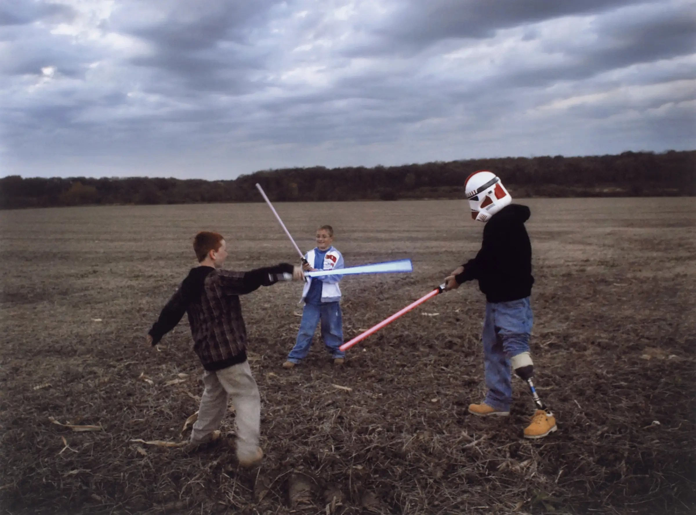 Raymond Hubbard, an Iraq War veteran with a prosthetic leg, puts on a Star Wars stormtrooper's helmet and engages his sons in a light-saber battle. His father was similarly injured in Vietnam.