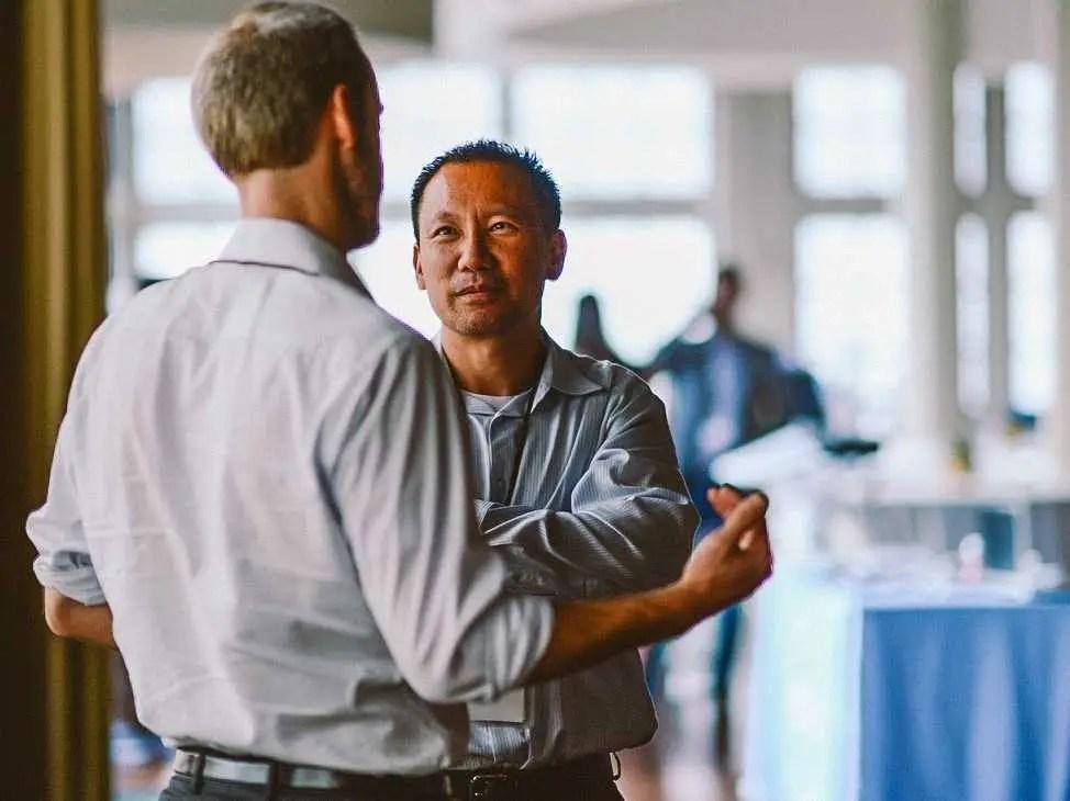 two men talking coworkers