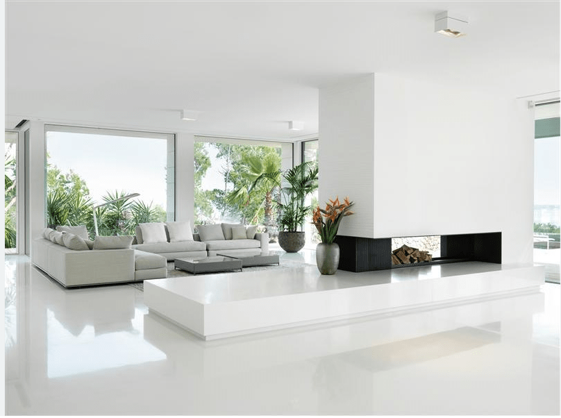 Clean white decor is a crisp contrast to the Mediterranean foliage outside.