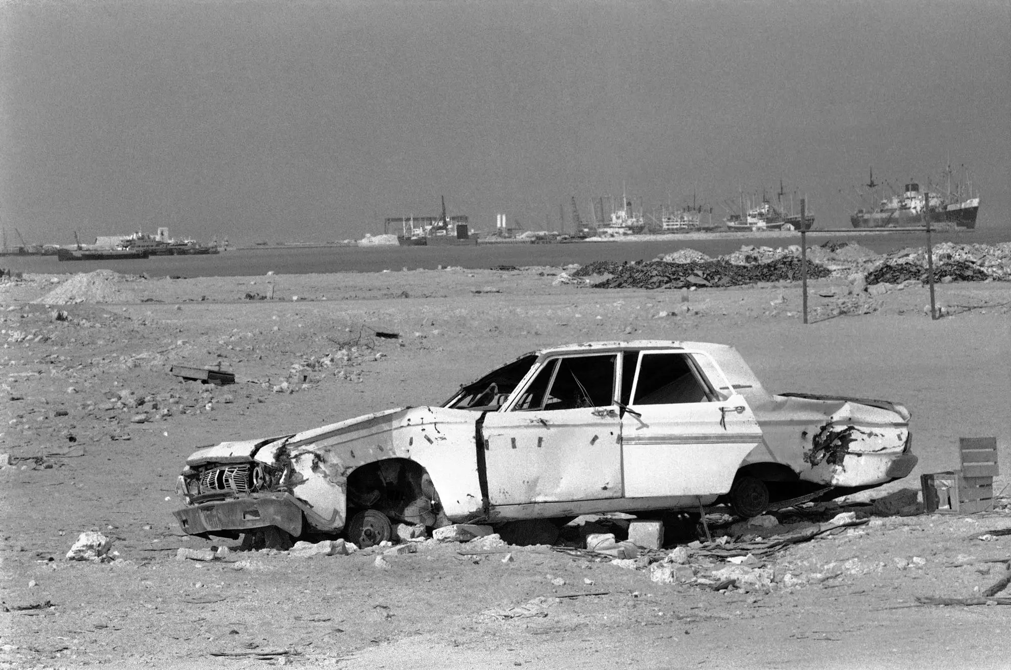 THEN: A discarded Plymouth Convertible American car is seen on the outskirts of the city in 1977, where it was dumped in the desert.