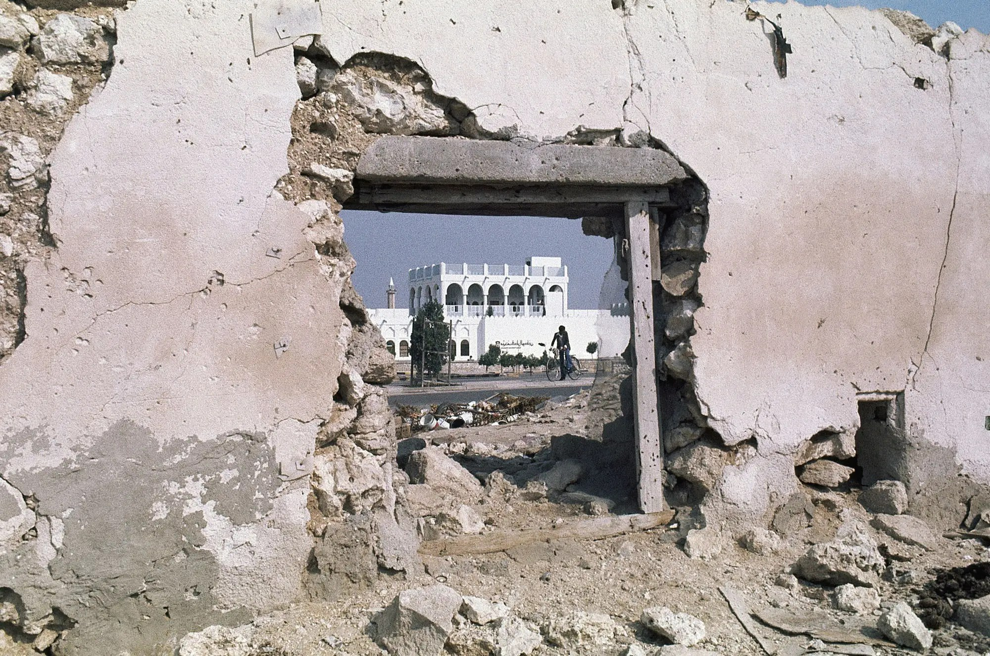 THEN: When it was first built in 1975, the Qatar National Museum in Doha was quite a big deal. Here it is in 1977, framed by a part of the crumbling old city.