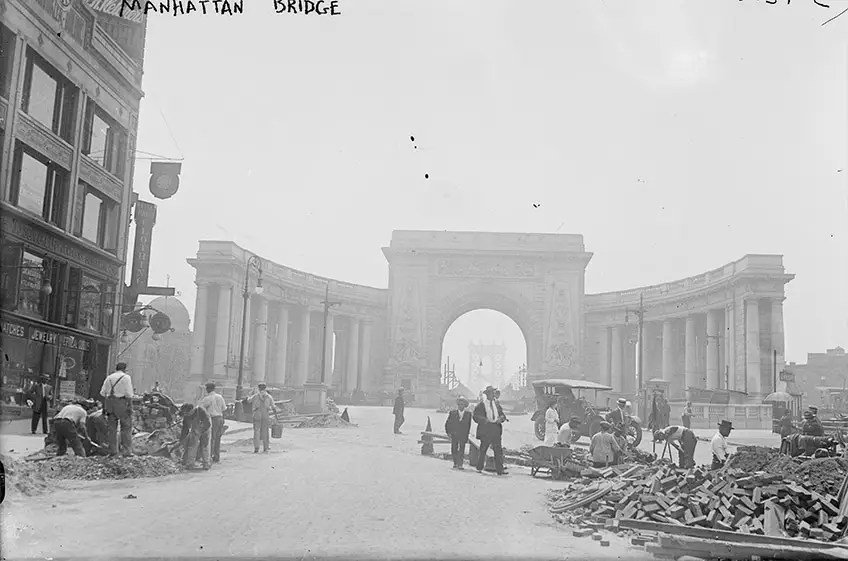 "1915: The arch and colonnade that welcomes motorists on the Manhattan Bridge was built as a part of the City Beautiful movement ""to create moral and civic virtue among urban populations."""