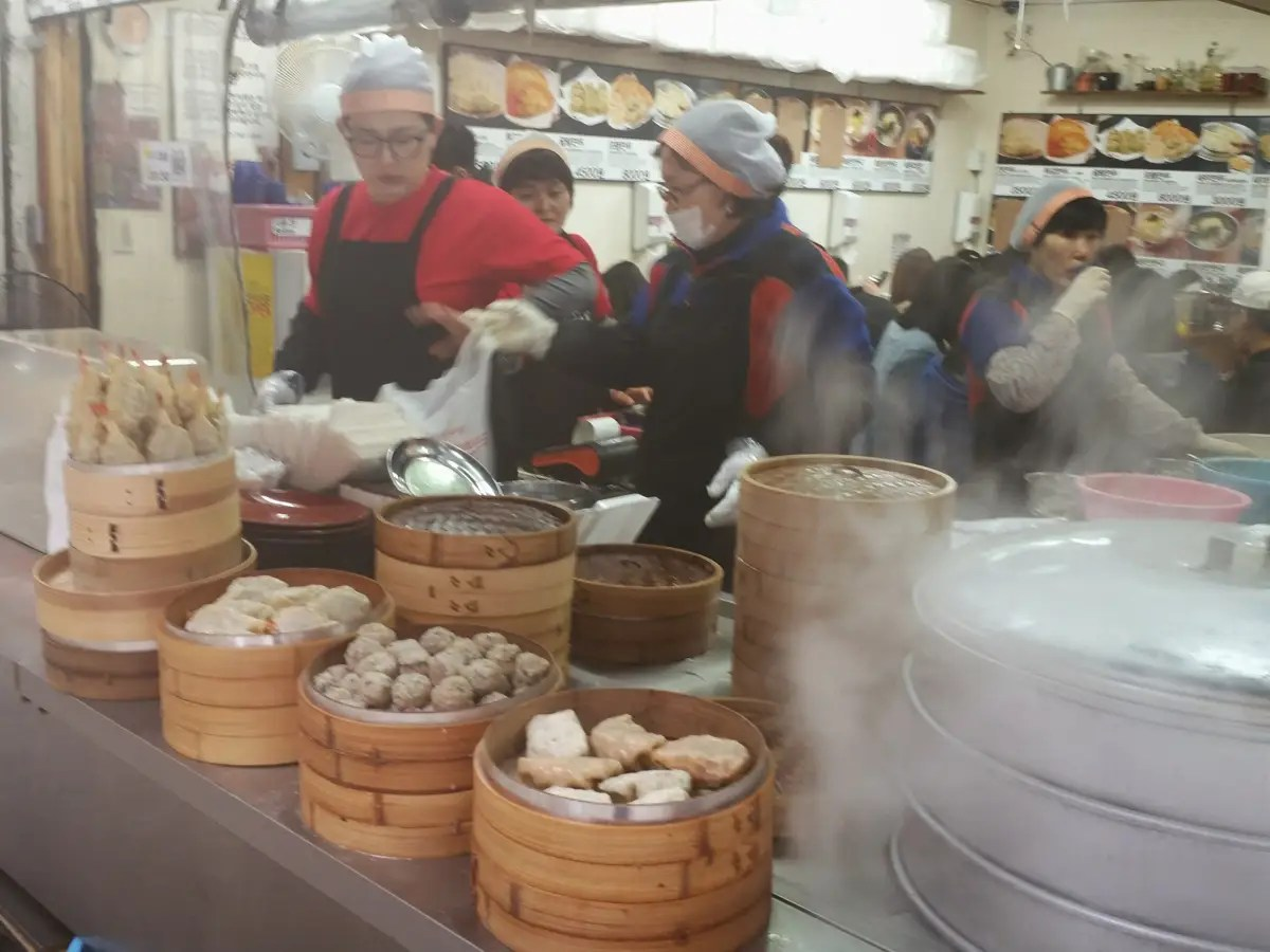 This stand was packed with people munching on platters of dumplings.