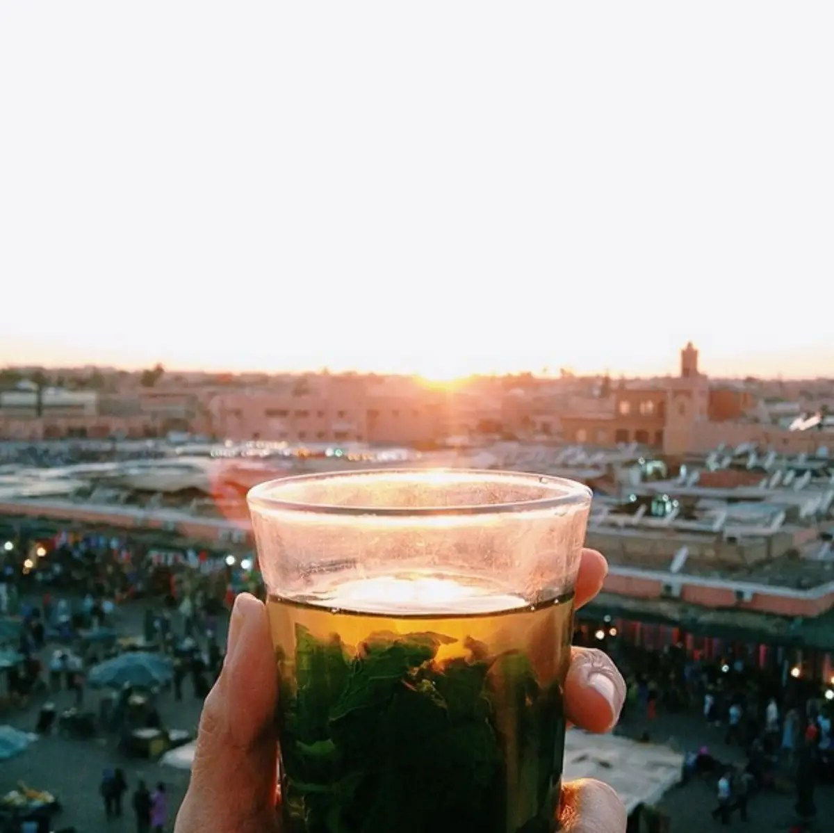 Sunset watch with Thé à la menthe (Mint Tea) at Djema El-Fna in Marrakesh, Morocco.