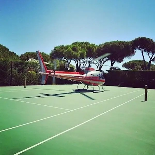 Their private tennis courts double as helicopter landing pads.