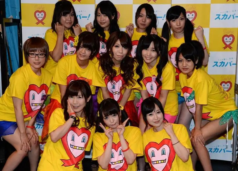 Nine Japanese porn actresses pose with three supporters (front) in Tokyo on August 30, 2014, ahead of a