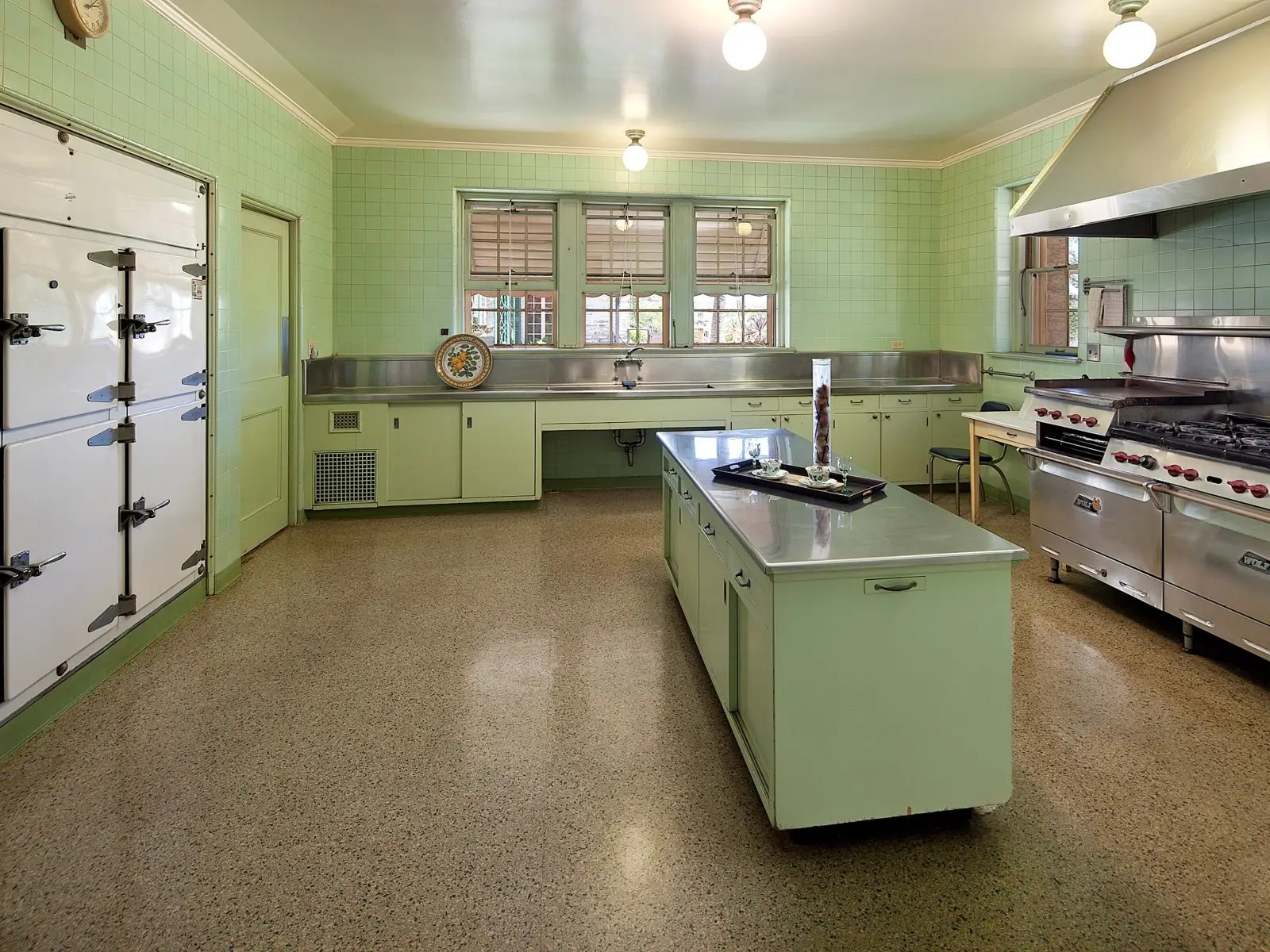 The chef's kitchen is huge with a restaurant-sized refrigerator and stove top.