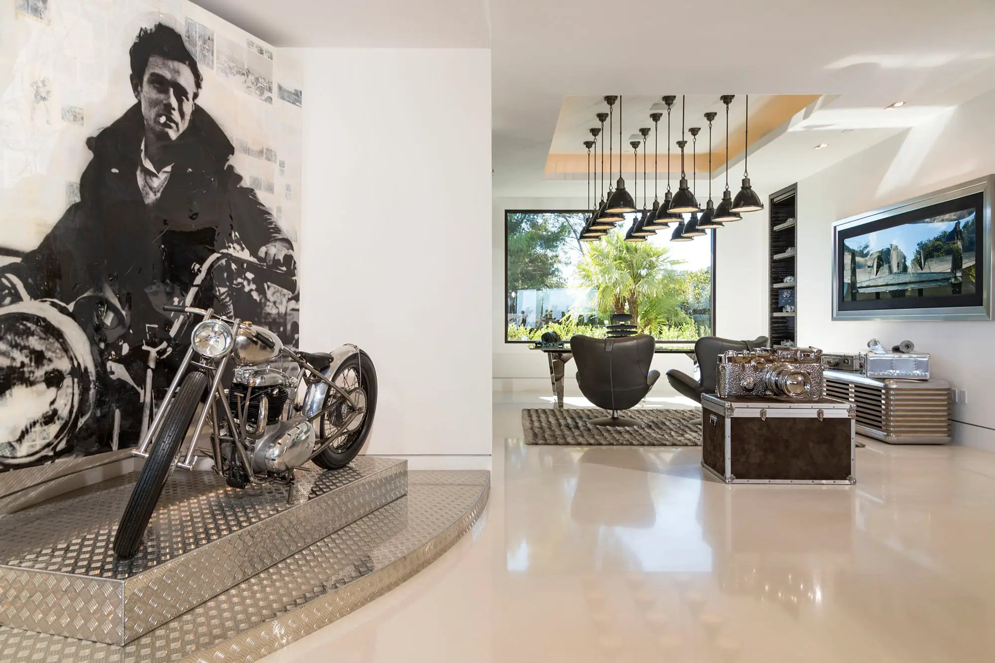 An open office is off to the side, with a motorcycle on display.