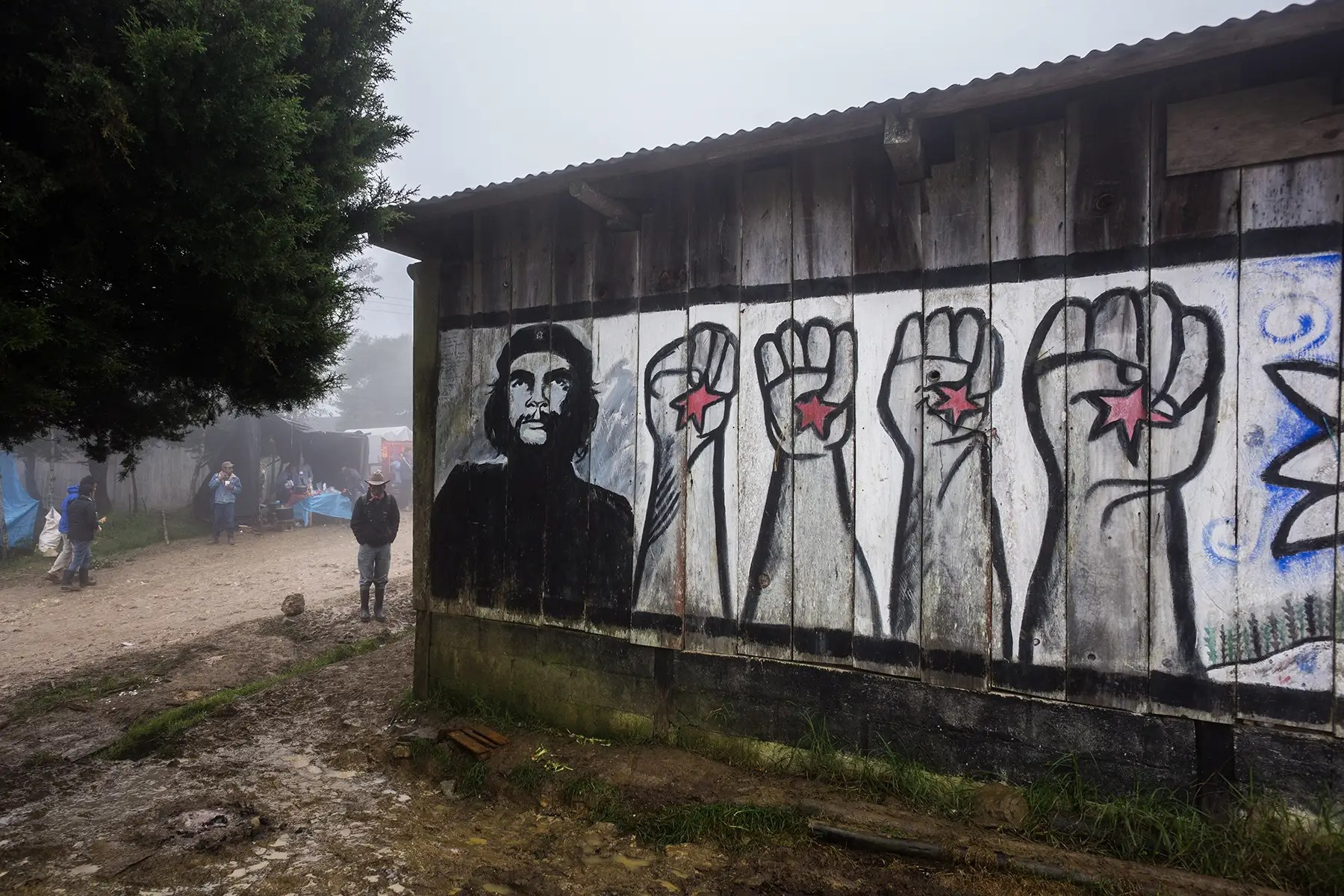 "Zapatista art and murals has long depicted cultural heroes of resistance, like Emiliano Zapata or Che Guevara, seen here. A sign on the outskirts of one of the towns reads, ""'Here, the people give the orders and the government obeys."""