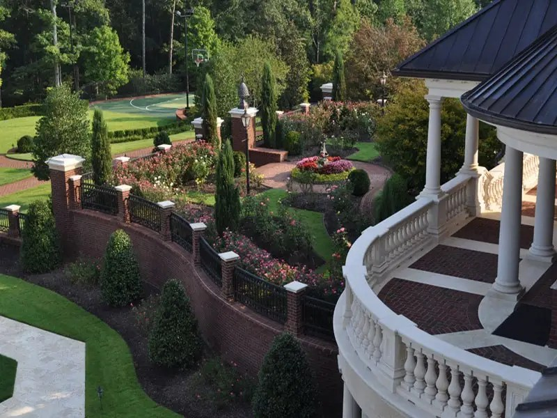 Gardens and landscaped walls surround the house, true to the estate's name.