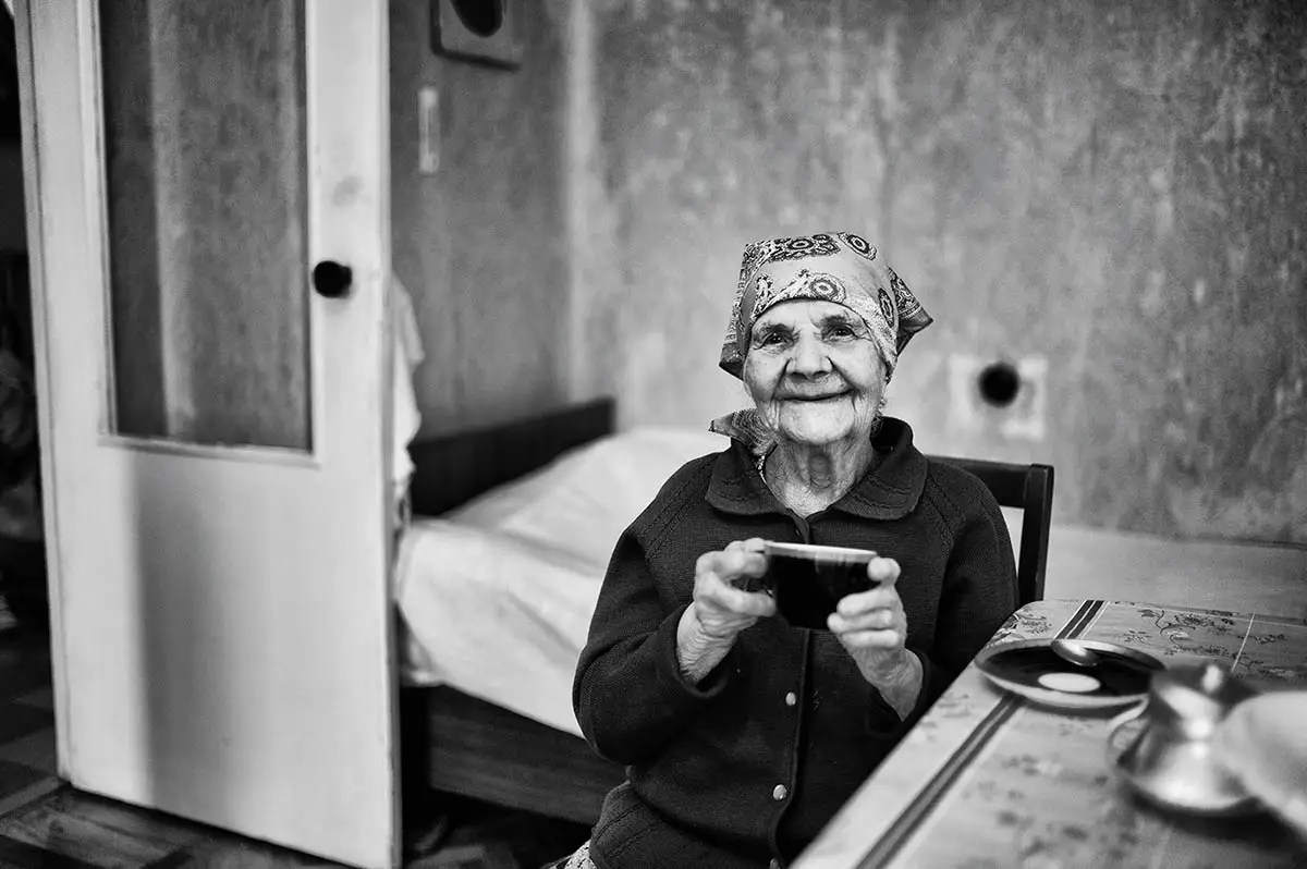 "Evdokiya, age 100. Profession: Worker. Passion or Dream: ""I dream of walking by myself, being independent and alive."""
