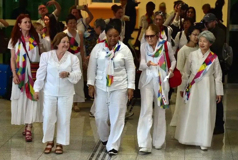 US feminist Gloria Steinem (2nd R) arrives with other peace activists at the inter-Korea transit office after they crossed the DMZ separating the two Koreas, in Paju, on May 24, 2015